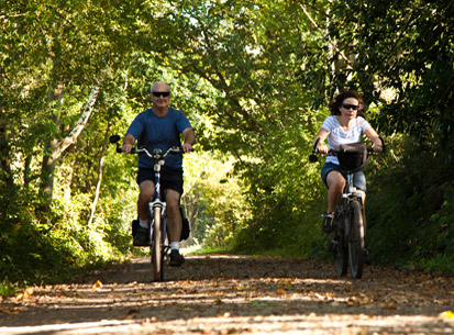 cyling couple on disused railway