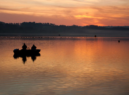 reservoir fishermen sunset